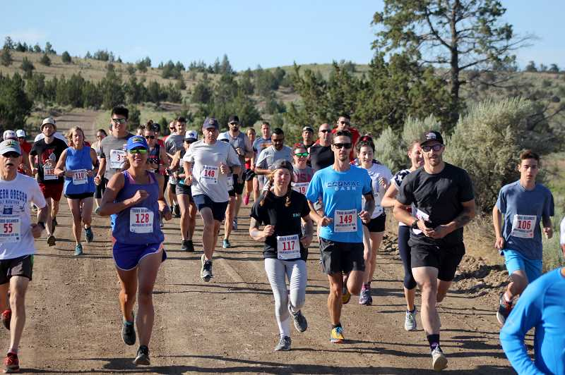 MADRAS PIONEER FILE PHOTO  - Runners at the start of the 10-K part of the 2019 Todd Beamer Memorial Run. The 2021 event may be the last event honoring Beamer and raising money for a scholarship in his name. Todd Beamer died in 1997. He was running with family dogs along an irrigation canal and drowned, it is suspected, when he entered the high-flowing canal to try and rescue at least one of the dogs that was having trouble with the current.