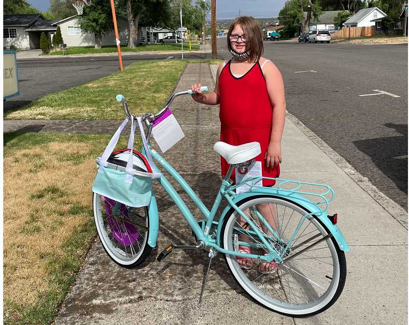PHOTO COURTESY OF WHITNEY BENNETT, COMMUTE OPTIONS - Madras Elementary School fifth grader Kayleigh Williams won a cruiser bike in the Walk and Roll Challenge raffle drawing.