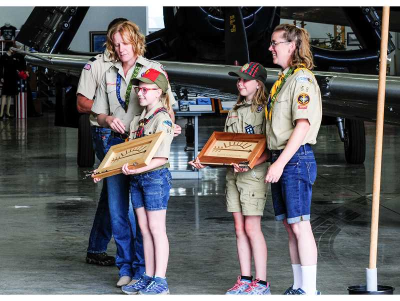 TOM BROWN/FOR THE PIONEER  - The first two members of the new local Scouts Troop are Caitlin Jones, left, and Evelyn Montgomery. The mothers behind the girls are Scoutmaster Laura Jones and Assistant Scoutmaster Kate Montgomery.