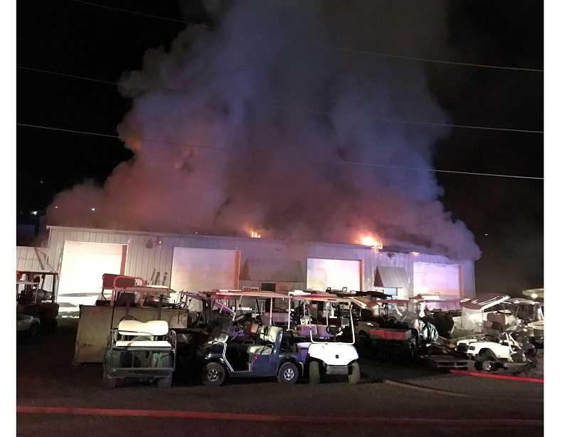 JEFFERSON COUNTY FIRE DISTRICT NO. 1 PHOTO - Fire crews had to make access through many golf carts and force doors to reach the fire at an automotive repair shop on Southwest Madison Street in Madras early Thursday.