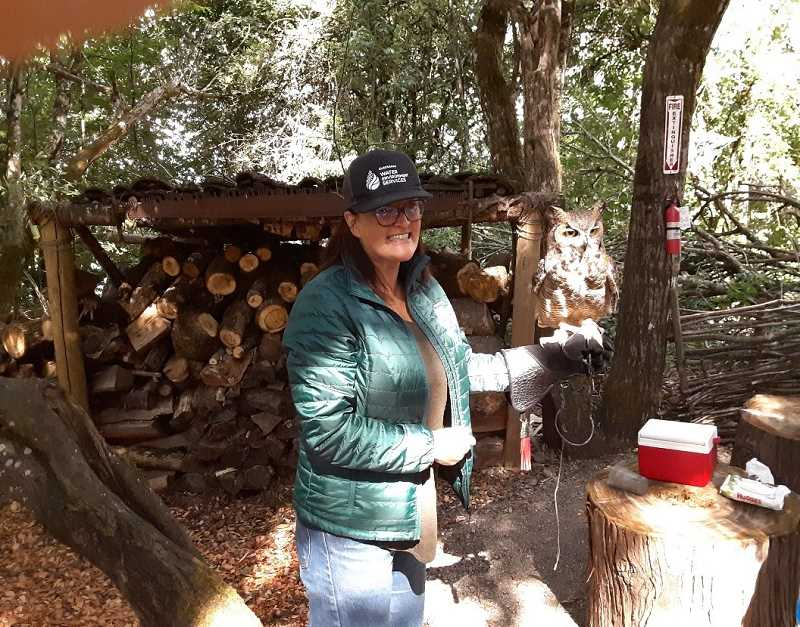 COURTESY PHOTO - Lori Bell of Clackamas Water Environment Services shows off one of seven birds of prey that youth are working with in conjunction with Clean Water Workshops sponsored through WES funding.