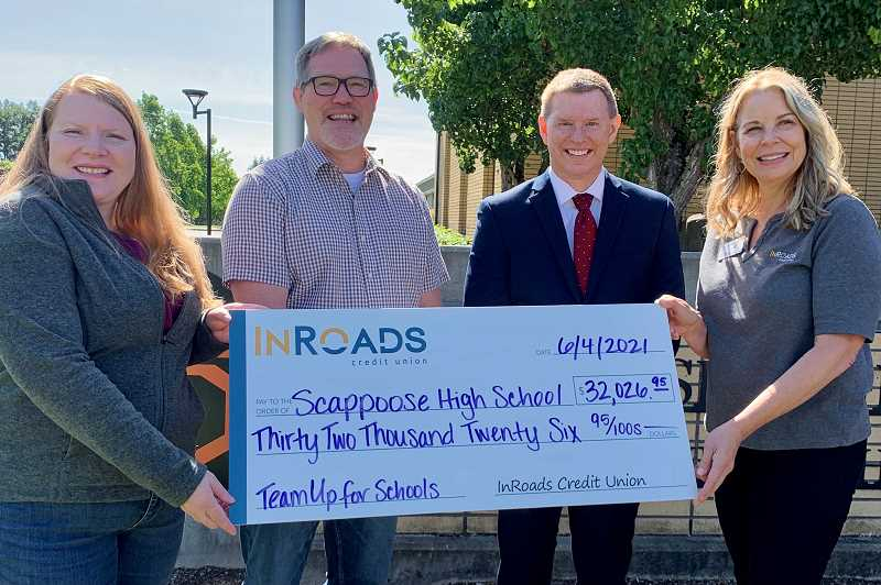 COURTESY PHOTO: INROADS CREDIT UNION - InRoads Credit Union Marketing Coordinator Annette Pixley, left, and President/CEO Brooke Van Vleet, right, present a check to Scappoose High School Principal Jim Jones and Scappoose School District Superintendent Tim Porter.