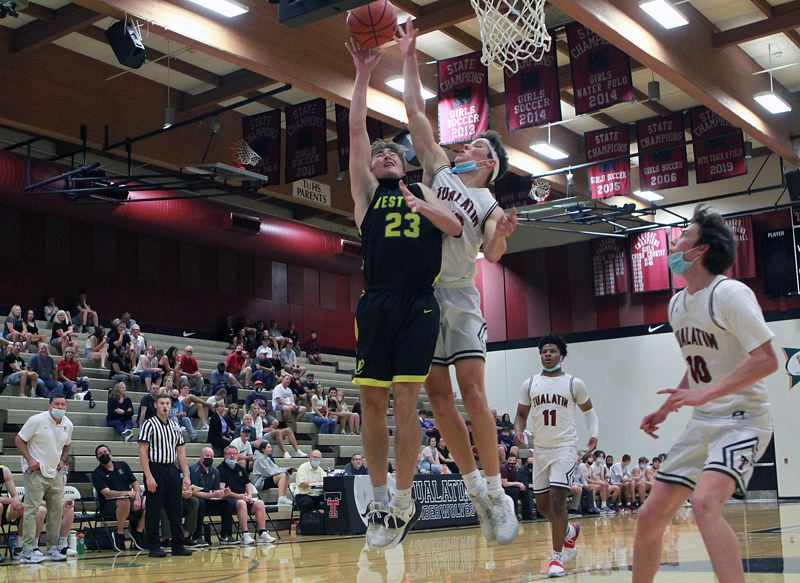 PMG PHOTO: MILES VANCE - West Linn junior Zeke Viuhkola goes up for a shot during his team's 51-42 win over Tualatin at Tualatin High School on Wednesday, June 16.