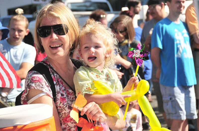 CONNECTION PHOTO: VERN UYETAKE - Beth Tupper, left, and Genevieve Adkin enjoy watching the 2018 Multnomah Days parade Saturday, Aug. 18 in Multnomah Village. , Southwest Community Connection - News Featuring a parade, live music, a kids zone and vendors, Multnomah Days provided a little something for everyone Multnomah Days photos: A day of fun