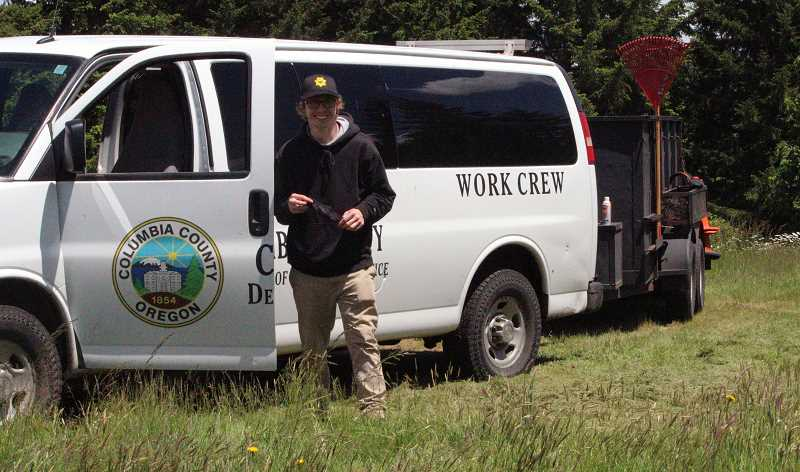 COURTESY PHOTO: COLUMBIA COUNTY - Work Crew Supervisor Jeremy Kaufman stands beside a work crew van at Neer City Cemetery.