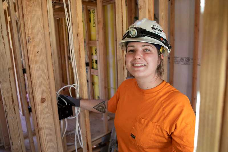 PAMPLIN MEDIA GROUP: JAIME VALDEZ - Dakotah Quinn, electrician and foreman, currently working on 18 townhomes for Green Hammer at 51st and East Burnside. HOMMA X is a community of energy-efficient, modern homes featuring integrated manageability and intuitive controls.