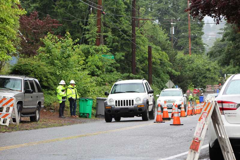 PMG PHOTO: COURTNEY VAUGHN - Vehicles make their way along Southwest Garden Home Road amid traffic slowdowns as the SW Capitol Highway Improvement project kicks off.