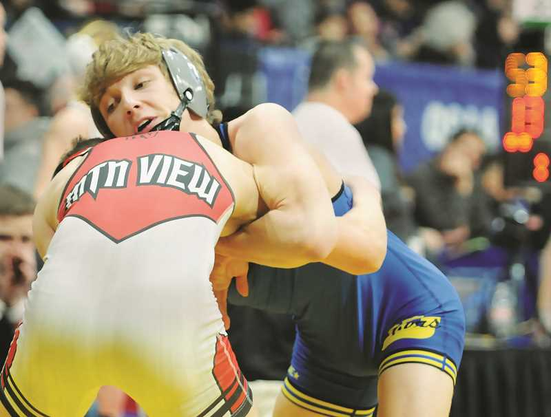 PMG FILE PHOTO - The NHS wresting team, including defending state champion Ayden Garver, will face a few more conference foes before the Tigers participate in the Pacific Conference championships.