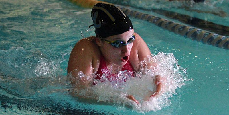PMG PHOTO: MILES VANCE - Lakeridge sophomore Riley McDowell splashes to victory in the 100-yard breaststroke during her team's meet against Lake Oswego at Lake Oswego School District Pool on Tuesday, June 15.
