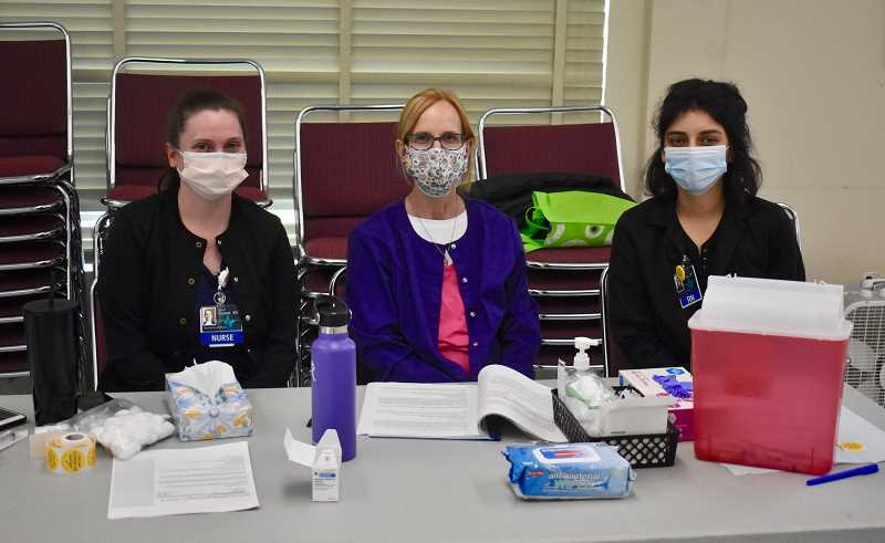 PMG PHOTO: EMILY LINDSTRAND - Medical personnel were on site during a recent COVID-19 vaccination clinic at the Estacada Community Center.