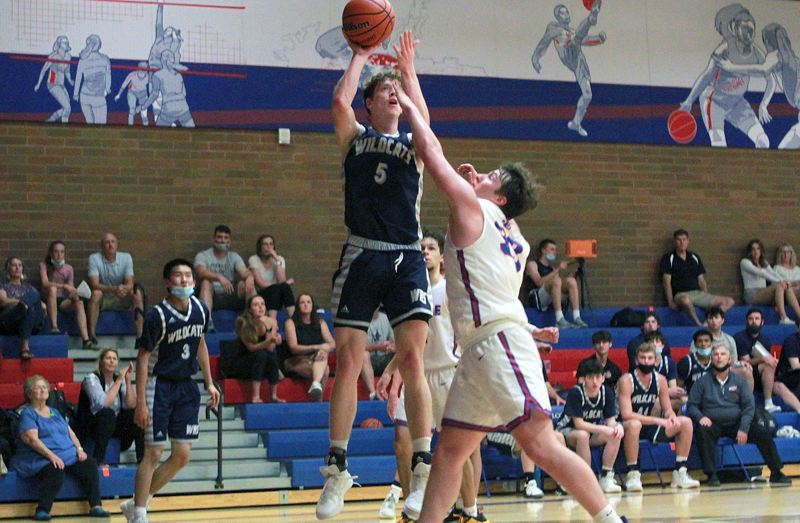 PMG PHOTO: MILES VANCE - Wilsonville senior Riley Scanlan goes up to score during his team's 48-35 win over La Salle at La Salle High School on Friday, June 18.