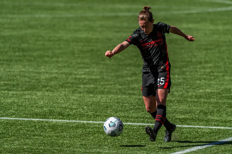 PMG PHOTO: DIEGO G. DIAZ - Meghan Klingenberg and the Thorns return to NWSL play. She is looking forward to a big crown, not so much the predicted hot weather.