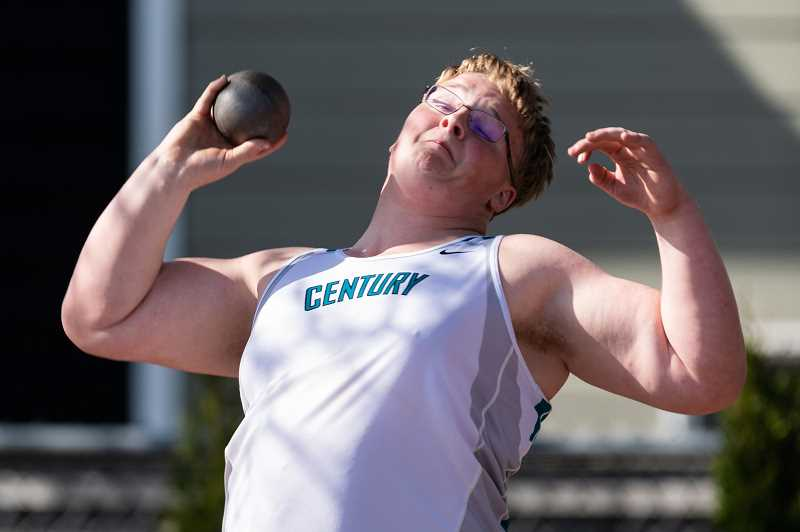 (PMG PHOTO: CHRISTOPHER OERTELL) - Brody Reese throws the shot put during a Century High School meet. Reese is a three-sport athlete for the Jaguars.