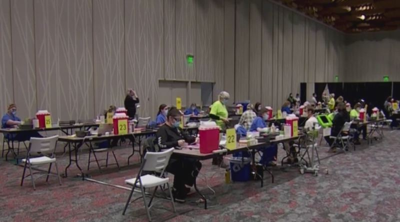 COURTESY PHOTO: KOIN 6 NEWS - Health care providers administer COVID-19 vaccines to eligible people at the Oregon Convention Center on Jan. 21.