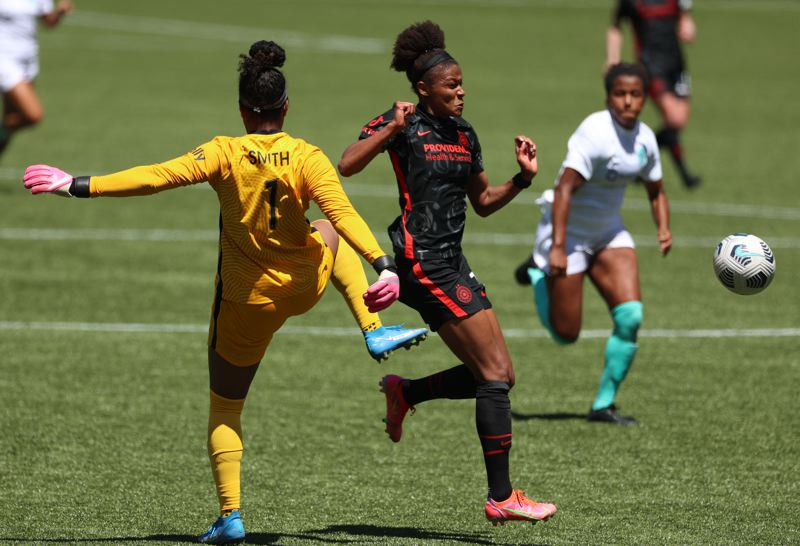 COURTESY PHOTO: CRAIG MITCHELLDYER/PORTLAND THORNS FC - Simone Charley beats KC goalkeeper Abby Smith to the ball to set up Charsley's goal for the Thorns just before halftime Sunday, June 20, at Providence Park.