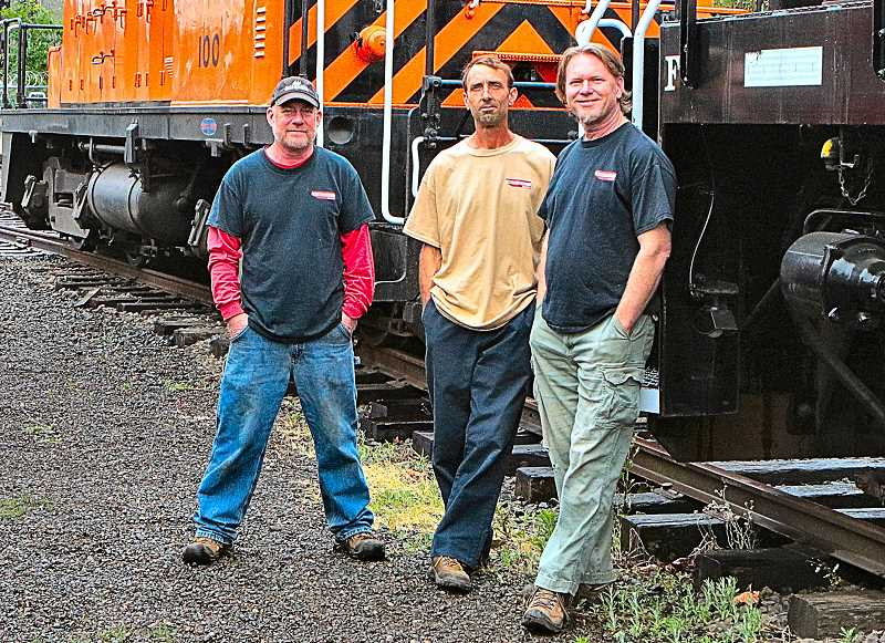 DAVID F. ASHTON - About to return to their work in the Oregon Pacific Railroad railyard are brothers Craig, Brian and Tim Samuels. His sons carry on their fathers business, including running the SamTrak Oaks Bottom Excursion trains, enjoyed by so many over the years.