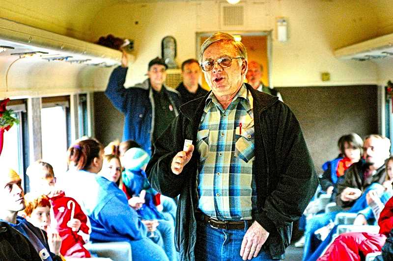 DAVID F. ASHTON - Heres Richard Samuels, on board a 2006 Holiday Express excursion, doing what he liked to do best: Talking with folks about preserving railroad history.