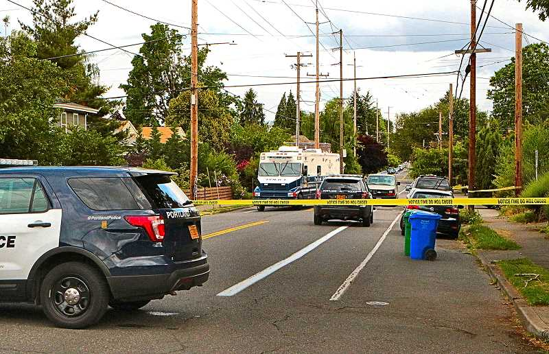 DAVID F. ASHTON - S.E. 42nd Avenue was closed to traffic near Boise Street for the police investigation, after a quadruple homicide in the Creston-Kenilworth neighborhood.