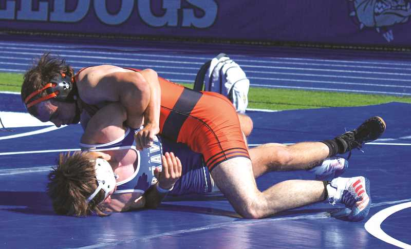 FILE PHOTO - Molalla High's wrestling program will send two boys and one girl to respective Class 4A state meets this week.