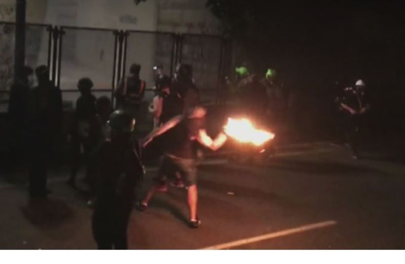 PMG FILE PHOTO - A protester throwing a  Molotov cocktail at the US Courthouse during a 2020 riot.