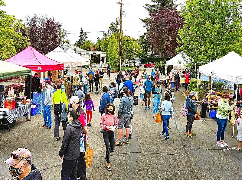 DAVID F. ASHTON - Minutes after the opening bell rang, signaling the start of the season on June 6th, shoppers streamed into the 2021 Woodstock Farmers Market.