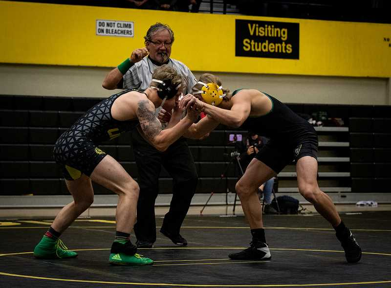 COURTESY PHOTO: MICHELLE NETT - At St. Helens High School, boys and girls compete on the wrestling team.