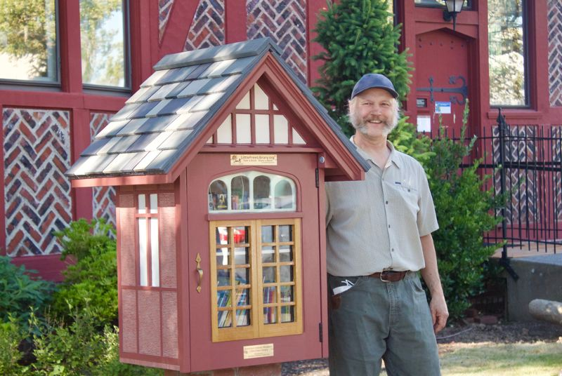 PMG PHOTO: CHRISTOPHER KEIZUR - Mark Klobas, who created the Little Library art piece, would visit the former Gresham Carnegie Library to read about the woods.