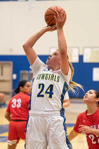 LON AUSTIN - Emma Bales concentrates as she shoots against Madras Friday, June 18. Bales had seven points against the Buffs. The Cowgirls dropped a close one to MHS, 47-46.