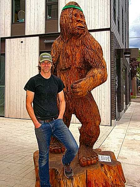 RITA A. LEONARD - Foot Traffic store owner Sean Rivers, shown with the Sellwood stores mascot - Miles the Bigfoot. The store has just moved across the street.