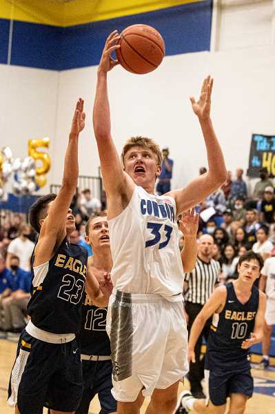LON AUSTIN - Cayden Lowenbach, 33, had a monster game against Hood River Valley. The Linfield-bound senior post scored 25 points and pulled down 17 rebounds. He also had four blocks on defense and threw down three dunks on the night.