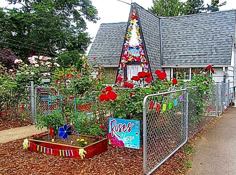 ERIC NORBERG - Brentwood-Darlington was represented in the Southeast Porch Parades by Blossoms For Our Friends & Neighbors, an entry at 6247 S.E. Ogden Street, just a block from the neighborhoods own Community Center.