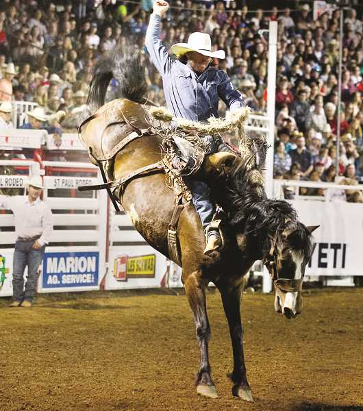 COURTESY PHOTO: HOOT CREEK - Cort Scheer rides Kool Toddy for 89 points at the 2019 St. Paul Rodeo, to break the arena record.