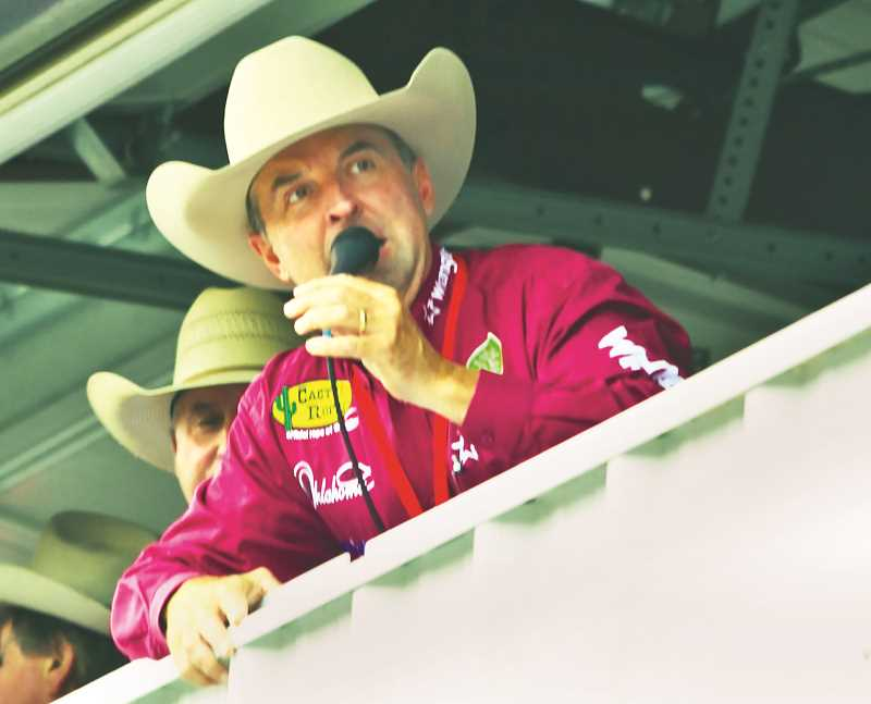 COURTESY PHOTO: HOOT CREEK - Oklahoma native Justin McKee leans out of the announcer's stand as he calls the action at the St. Paul Rodeo.