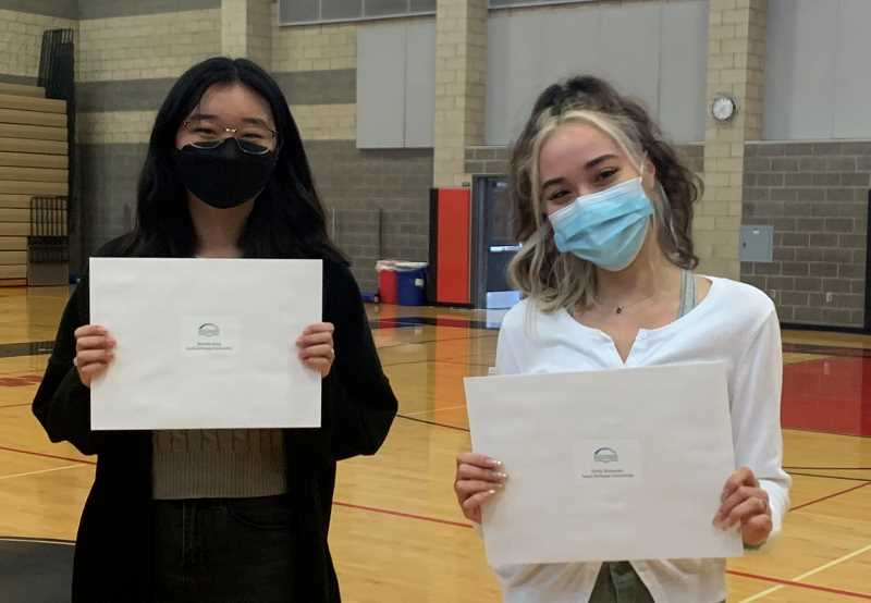 COURTESY PHOTO - Sandi DePaepe Scholarship winners Emily Alexander (left) and Michelle Bang each receive $4,000 upon graduation from Clackamas High School.