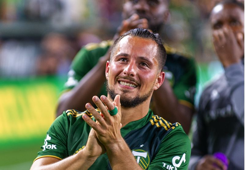 PMG PHOTO: DIEGO G. DIAZ - A happy Sebastian Blanco applauds fans after the Timbers match on June 19 against Sporting Kansas City. Blanco saw his first action in 286 days in Portlands 2-1 win.