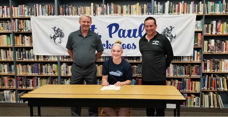 COURTESY PHOTO - St. Paul alumna Mary Davidson signs with Linn-Benton Community Colleges women's basketball team. From left: St. Paul girls basketball coach Dave Matlock, Mary Davidson, St. Pauls athletic director Tony Smith.