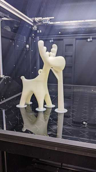 PHOTO: TYLER SMITH - Tyler Smith at Figure Plant test-printed this moose in about two hours. The chin support is the only way to print parts that would otherwise hang in the air.