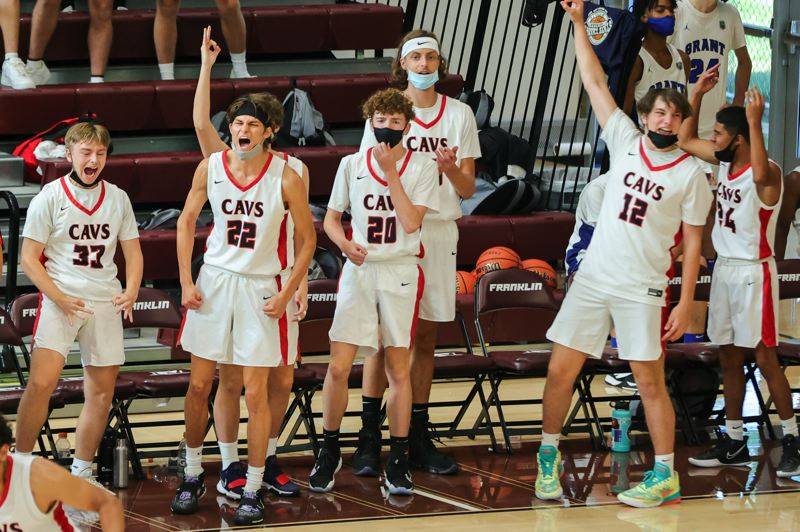 PMG PHOTO: JONATHAN VILLAGOMEZ - The Clackamas boys basketball team (from left, Parker Bresler, Levi Simmonds, Aiden Andrews and C.J. Borin) celebrates a play during their team's game against Jefferson in the finale of Blue bracket play at Franklin High School on Thursday, June 24.