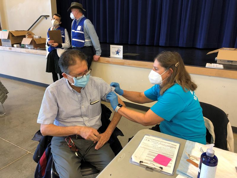 COURTESY PHOTO: WASHINGTON COUNTY - A man receives a COVID-19 vaccine dose at a Washington County-supported community vaccination clinic at St. Anthony's Catholic Church in Tigard.