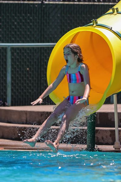 PMG PHOTO: JONATHAN VILLAGOMEZ - A girl prepares for a watery splash off a slide at the Sellwood Pool on Friday, June 26.