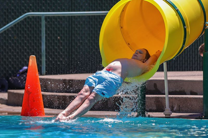 PMG PHOTO: JONATHAN VILLAGOMEZ - A young fellow takes it easy as he glides into the Sellwood Pool in Portland.