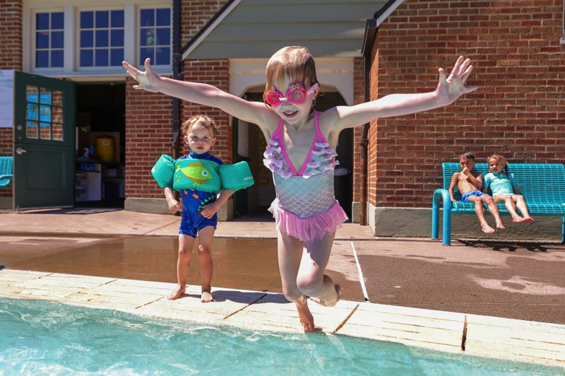 PMG PHOTO: JONATHAN VILLAGOMEZ - Children dived into the Sellwood Pool on Friday, June 25 in Portland.