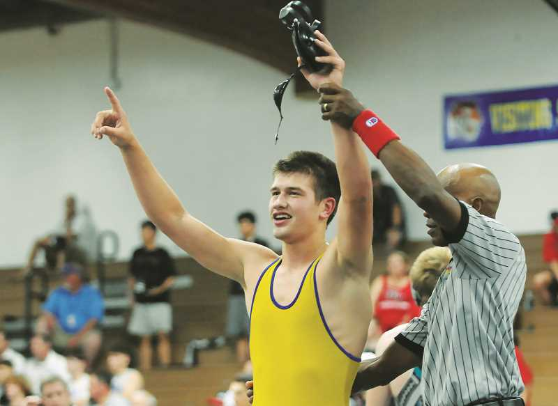 PMG PHOTO: GARY ALLEN - Charlie Evans earned the 152-pound crown Saturday, his second state title in as many years.