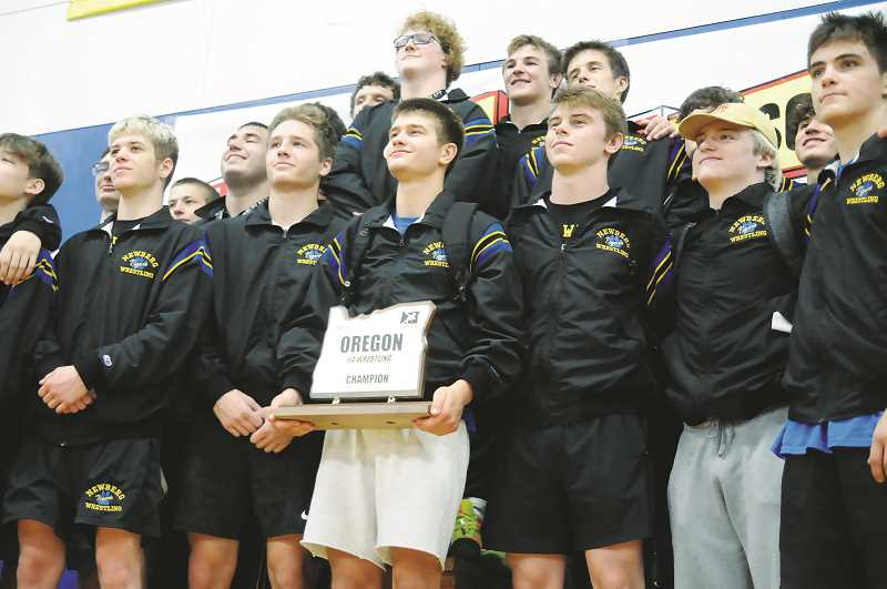 PMG PHOTO: GARY ALLEN - The Tigers scored 490.5 team points to win the 6A state championship Saturday. Newberg outdistanced second-place Sprague, which scored 261.5 points, and Roseburg, which earned 198.5 points.