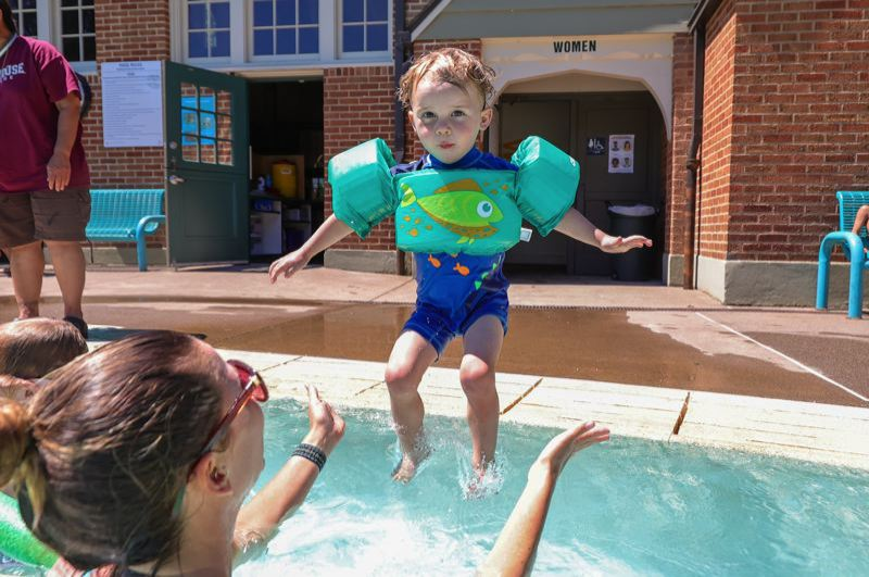 PMG PHOTO: JONATHAN VILLAGOMEZ - A youngster dives into the water at Sellwood Pool on Friday, Jine 25.