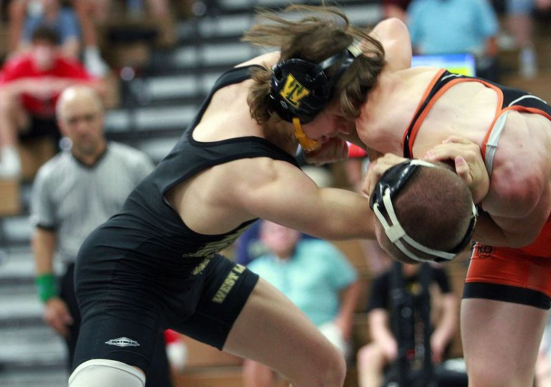 PMG PHOTO: MILES VANCE - West Linn junior Ethan Goff (left) battles Roseburg's Nathan Singleton in the 132-pound championship of the Class 6A state tournament at Newberg High School on Saturday, June 26.