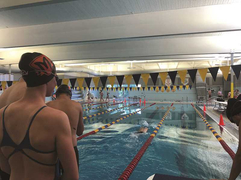 COURTESY PHOTO: MELISSA GEORGESEN - Getting ready for action, the Molalla High swim team gets warmed up for the state meet.