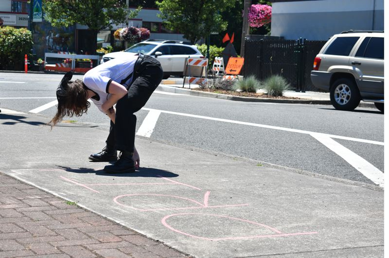 PMG PHOTO: STEVEN BROWN - A message of LGBTQ pride was written in chalk on the sidewalk at Centennial Plaza.   6. About 80 people attended the SAFE event Saturday in Sandy.