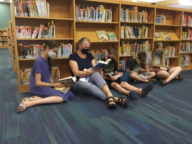 COURTESY PHOTO: WILSONVILLE PUBLIC LIBRARY - Brenna, Kellena (mom), Jace, Kruse, and Delaney Collier took to the Wilsonville Public Library to 'stay cool and relaxed' during the heatwave Monday.