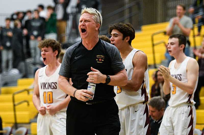 PMG FILE PHOTO - Forest Grove head boys basketball coach Greg Evers gets fired-up during a game in 2019. Evers is retiring from coaching after 31 years on the sideline.